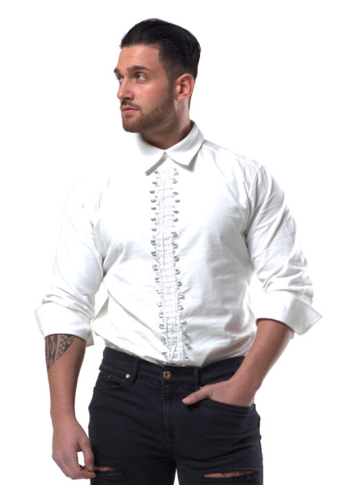 SAVELIEV's white brush cotton shirt opens at the back and is fastened with full length zip to the waist. It has a white collar and buttoned cuffs and ¾ length sleeves. The front is fitted with Safety pin decoration down the length to the waist. Material 100% Cotton